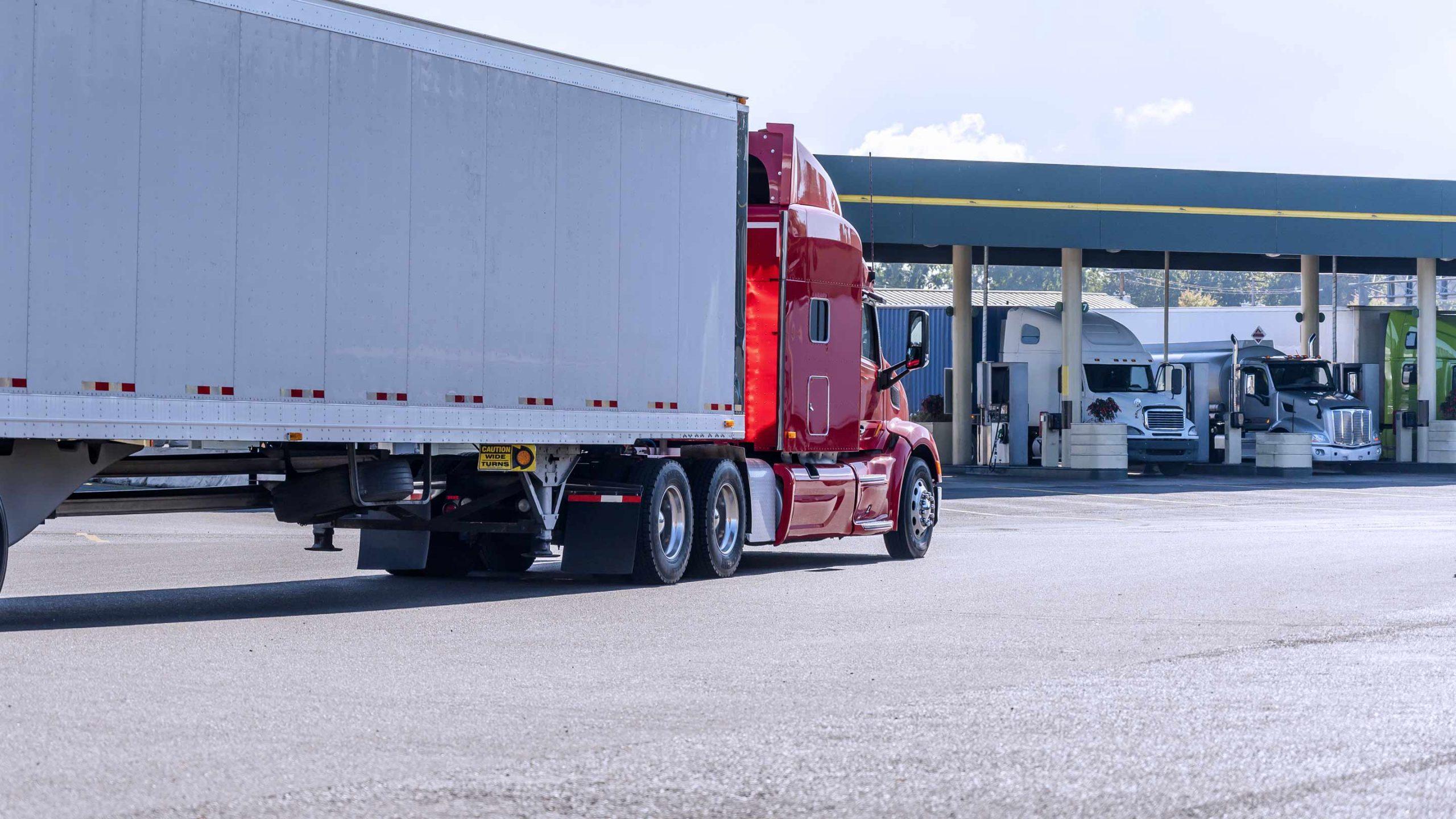 Transport Trucks Fuelling at Gas Station